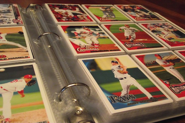 Numerous baseball cards are displayed in a binder. Collections such as these usually take many years to compile. Photo by John Loop