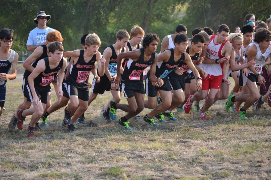 The+Varsity+boys+team+charges+from+the+starting+line+at+the+Prosper+Invitational.+Photo+by+Elizabeth+Sims.
