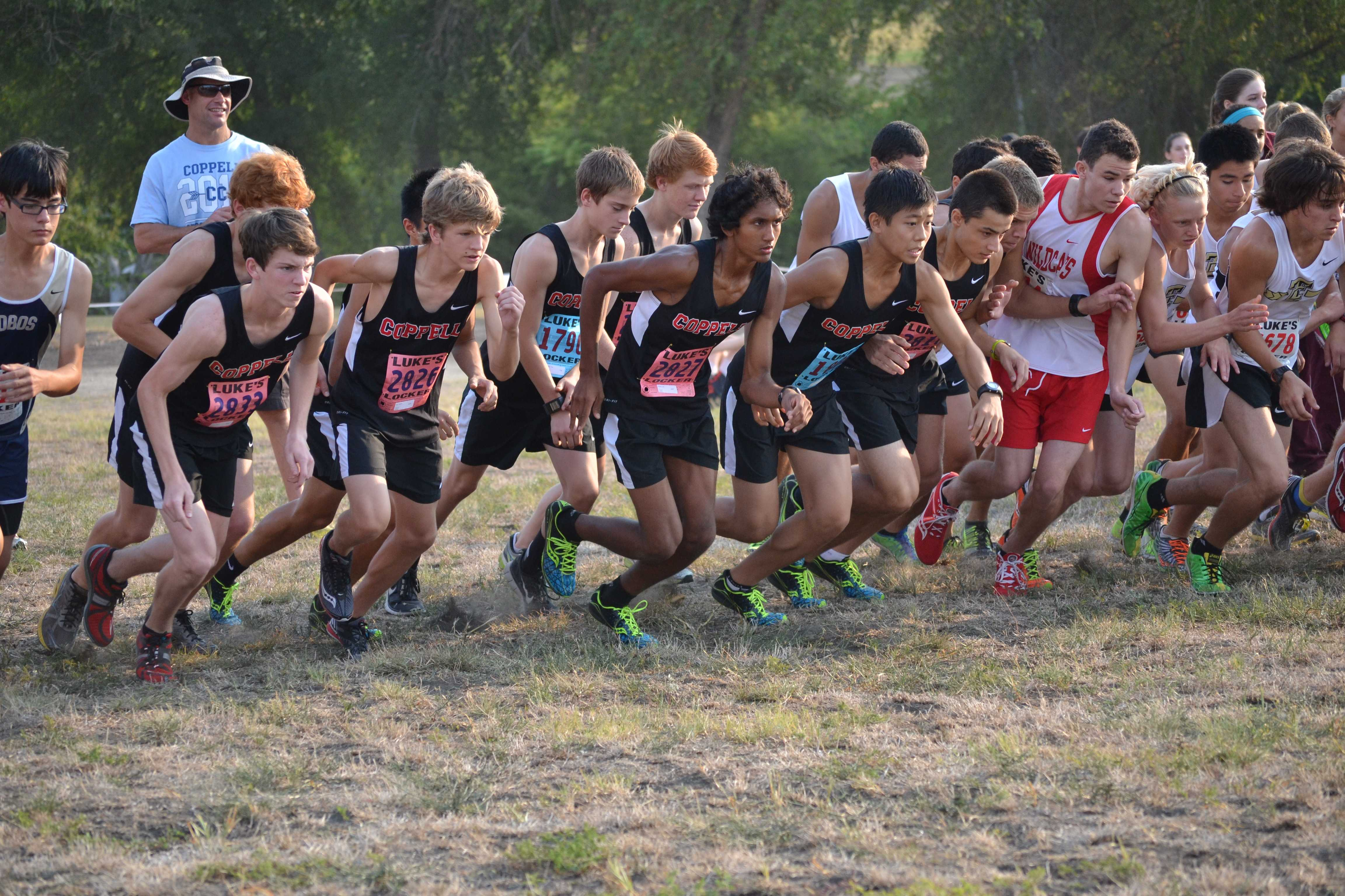 The Varsity boys team charges from the starting line at the Prosper Invitational. Photo by Elizabeth Sims.
