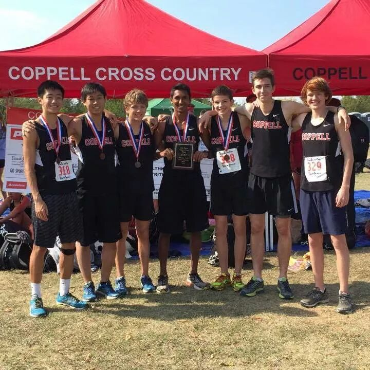Senior+Josh+Thomas+%28center%29+and+the+varsity+cross+country+boys+team+at+the+district+meet+receive+third+place+qualify+for+regionals+on+Oct.+23.+