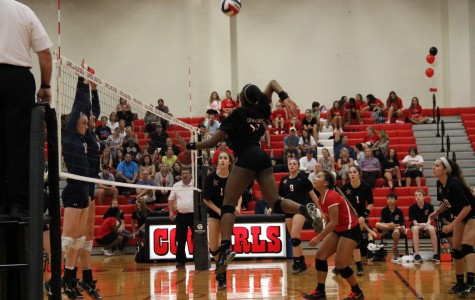 Volleyball spikes the Rebels to improve district record