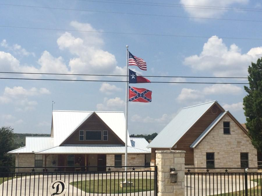 The+confederate+battle+flag+flying+alongside+the+American%2C+and+Texan+flag+over+a+general+store+in+Graford%2C+Texas.+Photo+Courtesy+Nicolas+Henderson.
