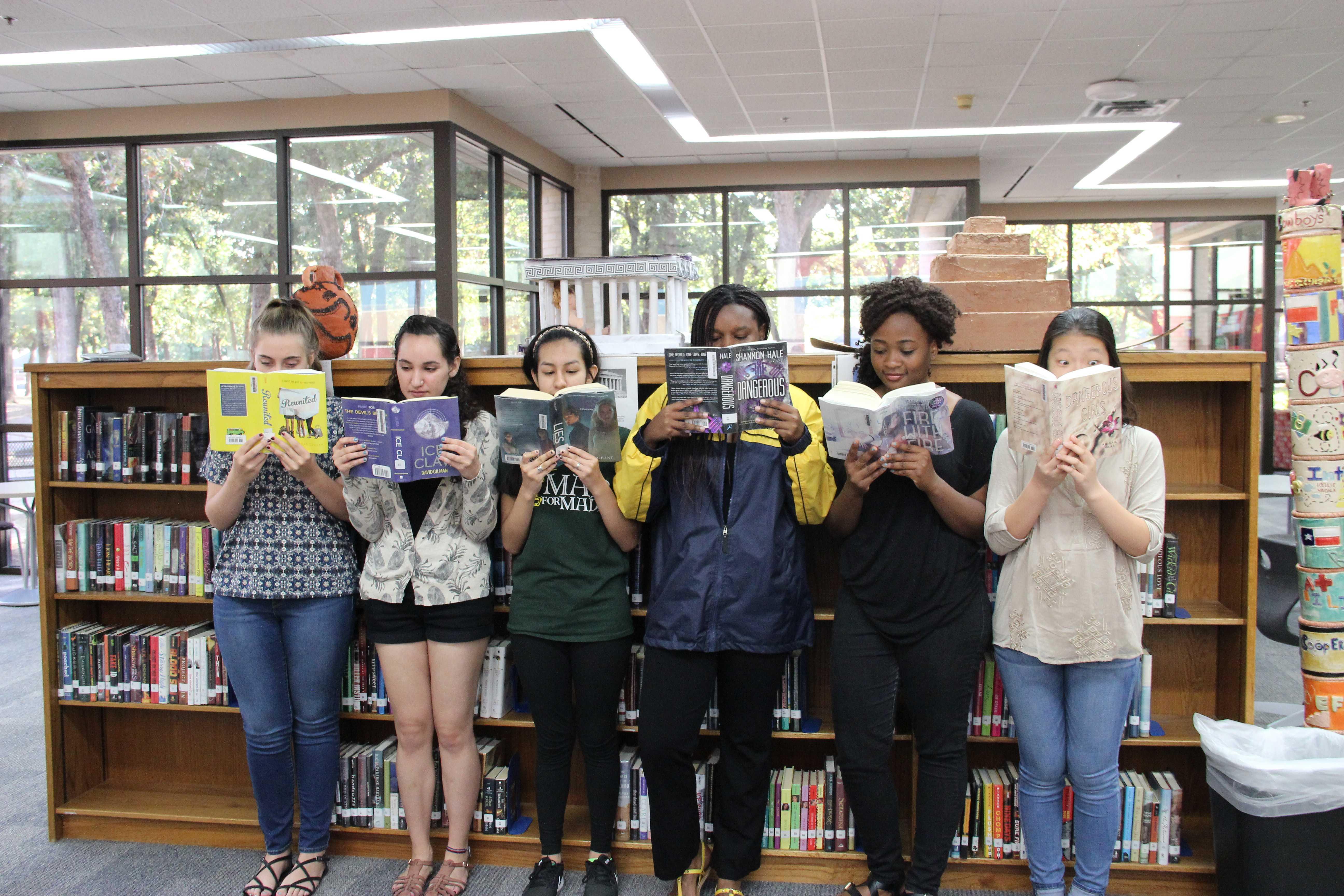Coppell High School seniors Leia Emerson, Iliana Diaz, Imelda Rivera, Lexi Muraga, Hauwa Oyebanji and junior Miley Shin enjoy the classics, as well as other modern novels.