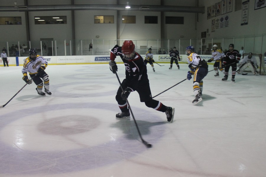 Junior+forward+James+Reaman+skates+down+the+ice+to+shoot+the+puck+last+season+on+December+18th+against+Highland+Park.+Coppell+went+on+to+win+9-4.+Photo+by+Stephanie+Alexander.