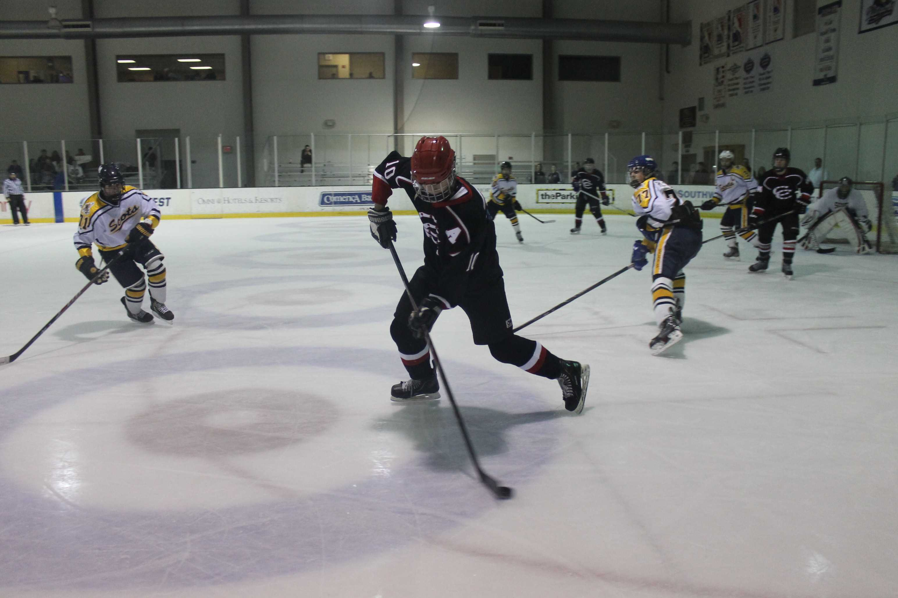 Junior forward James Reaman skates down the ice to shoot the puck last season on December 18th against Highland Park. Coppell went on to win 9-4. Photo by Stephanie Alexander.