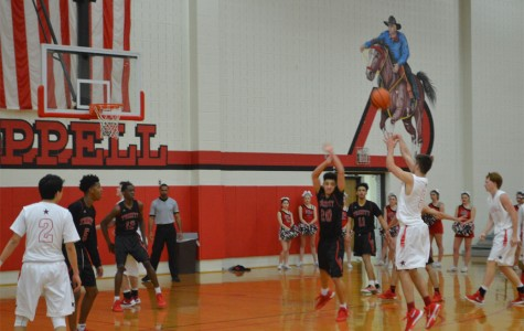 Cowboys and Trojans put up a close fight on the court