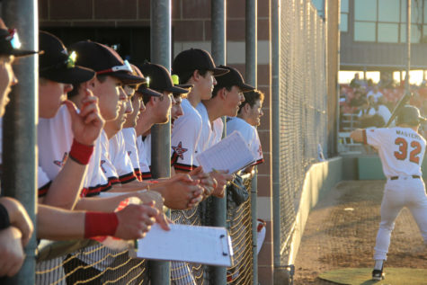 The Cowboys watch the field as Cole Solomon is at bat. The Cowboys won their district game 2-0 against Colleyville Heritage. Photo by Ayoung Jo.
