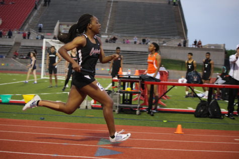 Coppell High School junior Lauren Cunningham sprints to the finish line at the end of the women's 4x200 relay. The District 7-6A Track & Field Meet was held at Buddy Echols Field and athletes from all over the district participated in events on Monday and Tuesday. Photo by Kelly Monaghan.