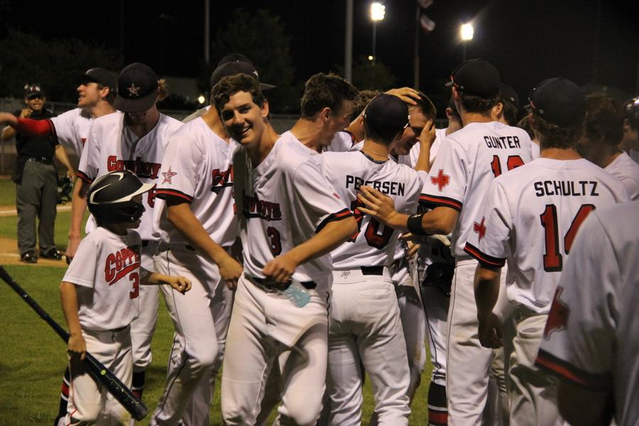 The Cowboys celebrate as Trey Becerra strokes a grand slam over the left field wall which increased their lead to 12-0 in the fourth inning of the second game of Wednesday night's doubleheader against the Haltom Buffalos. The Cowboys played at the Coppell ISD Baseball/Softball Complex and the night ended with a 10-0 win in the first game and the second game ending 12-1.