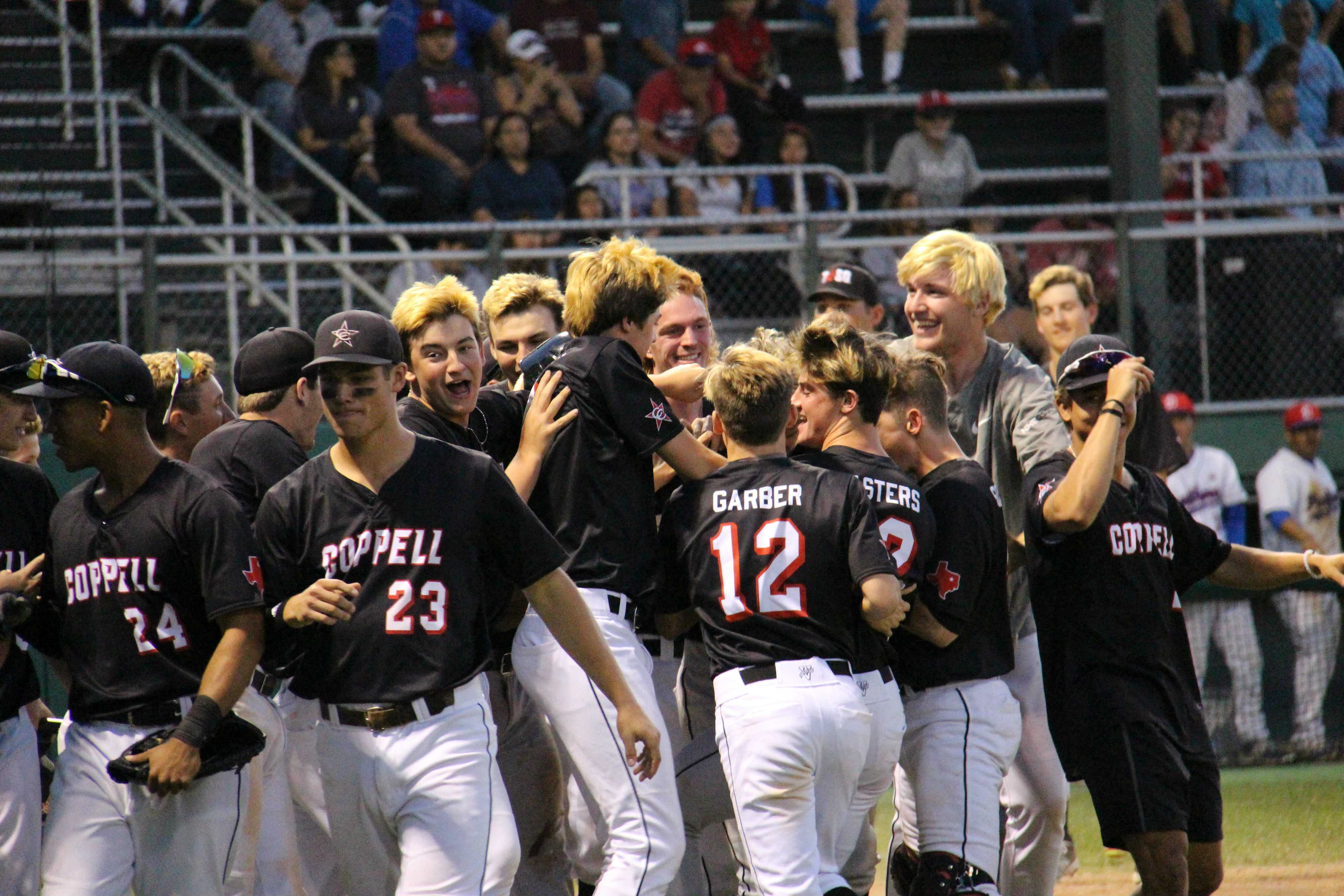 The Cowboys mob junior shortstop Jacob Nesbit after his two-run jimmy-jack broke the game wide open for Coppell. Nesbit's homer added two much-needed runs in the top of the sixth as the Cowboys would go on to win 8-1 in Duncanville.