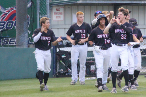 The Cowboys celebrate after scoring a run late in their 10-2 game two victory over McKinney Boyd. After falling in game one, Coppell came back and won by a combined score of 16-2 in the last two games of the series.