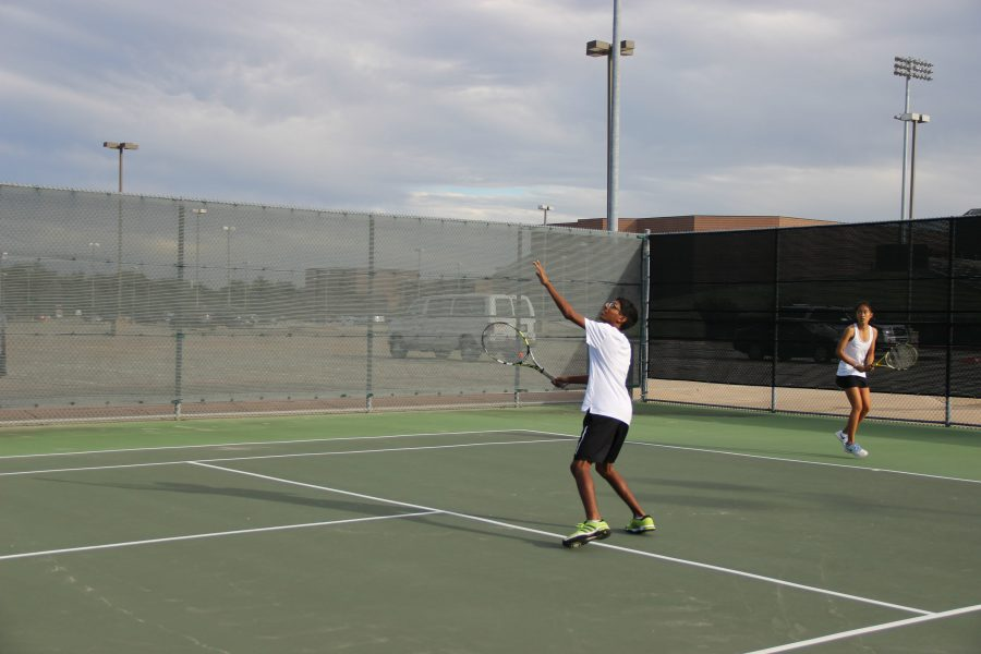 Arvind+Arunachalam+prepares+to+return+the+ball+back+to+the+Skyline+opponent+in+his+mixed+doubles+match.++Coppell+won+the+match+8-0.+Photo+by+Kelly+Wei.