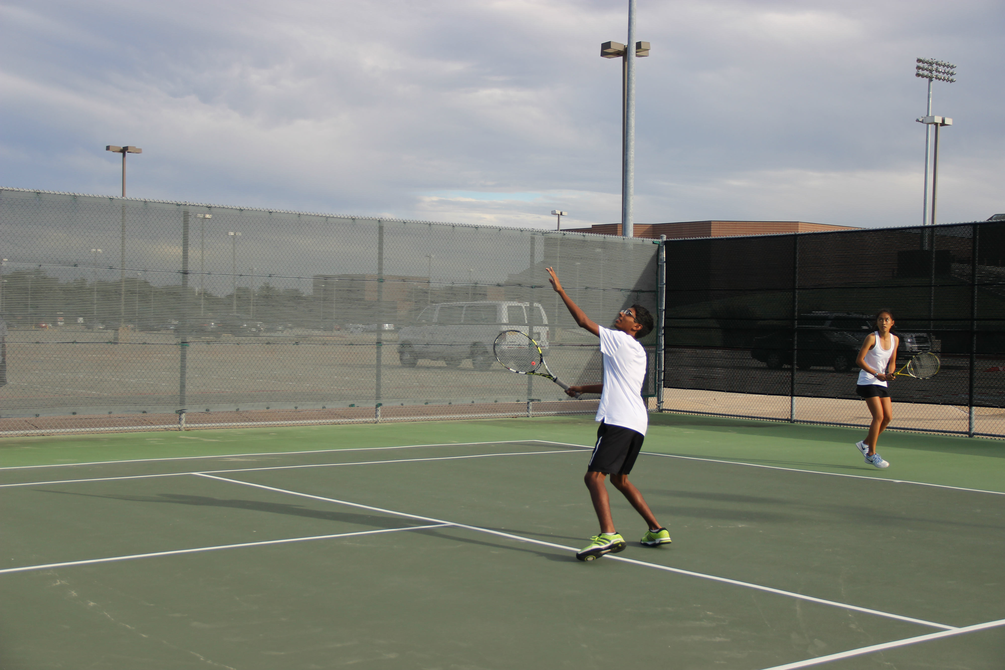 Arvind Arunachalam prepares to return the ball back to the Skyline opponent in his mixed doubles match.  Coppell won the match 8-0. Photo by Kelly Wei.