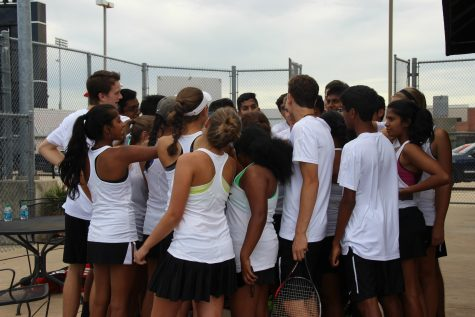 Coppell High School varsity tennis players huddle up and prepare for their match against Skyline High School on Tuesday. The Coppell Cowboys defeated Skyline, winning 19-0 in the Senior Night district matchup. Photo by Kelly Wei.