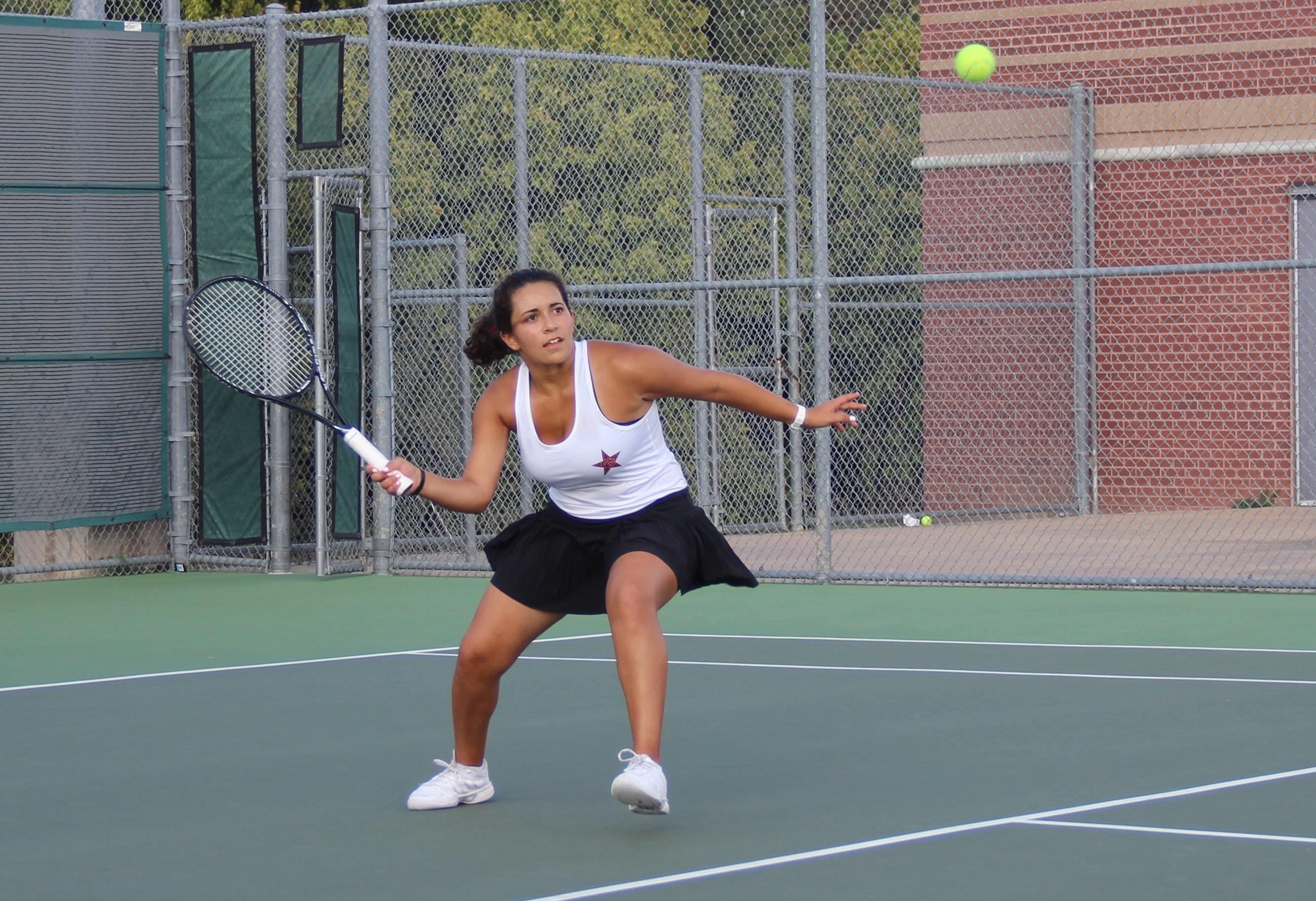 Senior tennis player Laila Kamel strikes the ball during her 4-6, 6-0, 10-7 doubles victory in Coppell's win over Rowlett. Although Kamel and her partner Akshaya Kannan dropped the first set, they battled back to help the team sweep Roulette.