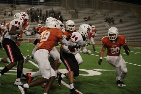 Senior running back Thomas Donaldson fights through defenders on a run in the fourth quarter. Donaldson had 33 total yards in Coppell's 40-14 win over W.T. White. Photo by Kelly Monaghan.