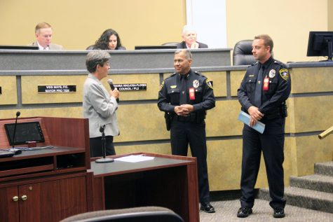 Coppell Mayor Karen Hunt Talks with Police Chief Mac Tristan and Officer Peter Dirks about the dangers of drug abuse and the start of Red Ribbon Week. Photo by Sophia Guerrero.