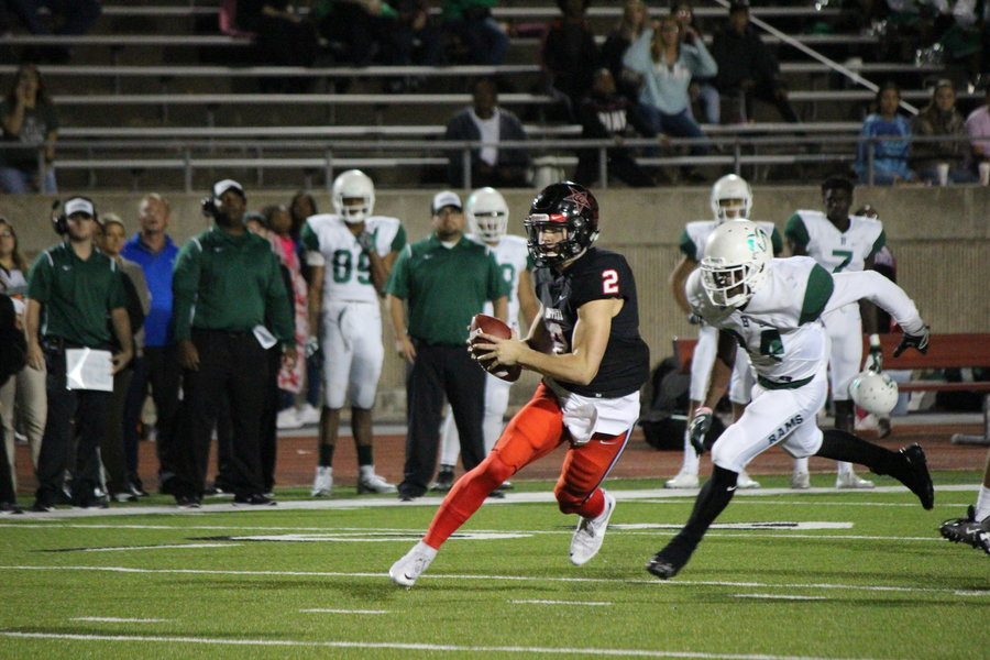 Coppell High School junior Brady McBride carries the ball past the Berkner defense Friday night at Buddy Echols Field. The Cowboys beat Berkner 42-7 to move to 4-1 in District 9-6A play.