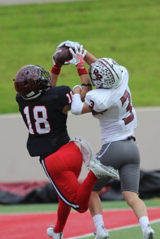 With minutes remaining in the second quarter, Coppell High School senior Matt Dorrity jumps to catch a pass from CHS junior Brady McBride. After a close matchup, the Round Rock Dragons defeated the Coppell Cowboys with a final score of 49-45 at WISD Stadium.