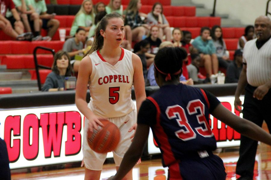 Coppell+High+School+junior+shooting+guard+Emma+Johnson+dribbles+down+the+court%2C+looking+for+an+open+teammate+in+last+year%27s+matchup+against+Keller.+Johnson+Coppell+with+10+points+in+Friday%27s+loss+to+Denton+Guyer.