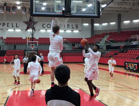 Senior guard Caeden Horak warms up with senior guard Christian Plummer before the game against McKinney Boyd on Tuesday at the CHS arena. The Cowboys won the game 64-54.