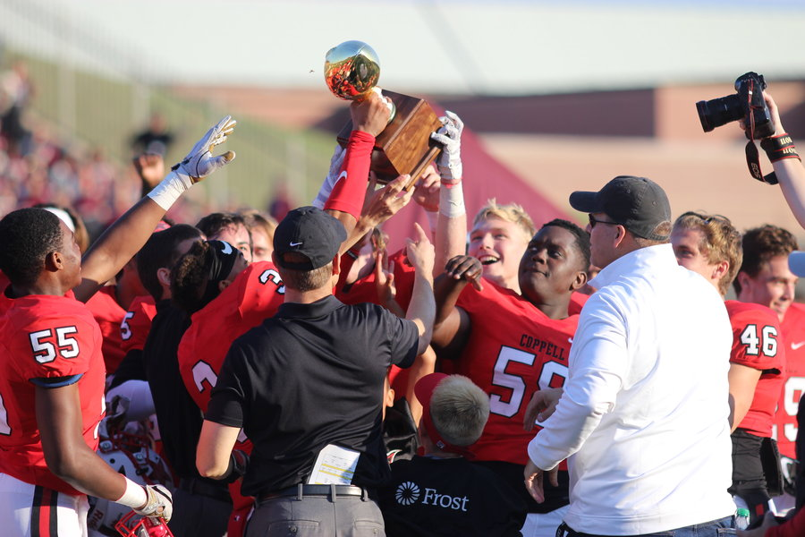 The Coppell High School varsity football team celebrates their Bi-District Region II Division I Championship on Saturday after defeating the Rowlett Eagles 27-20 at Buddy Echols Field.