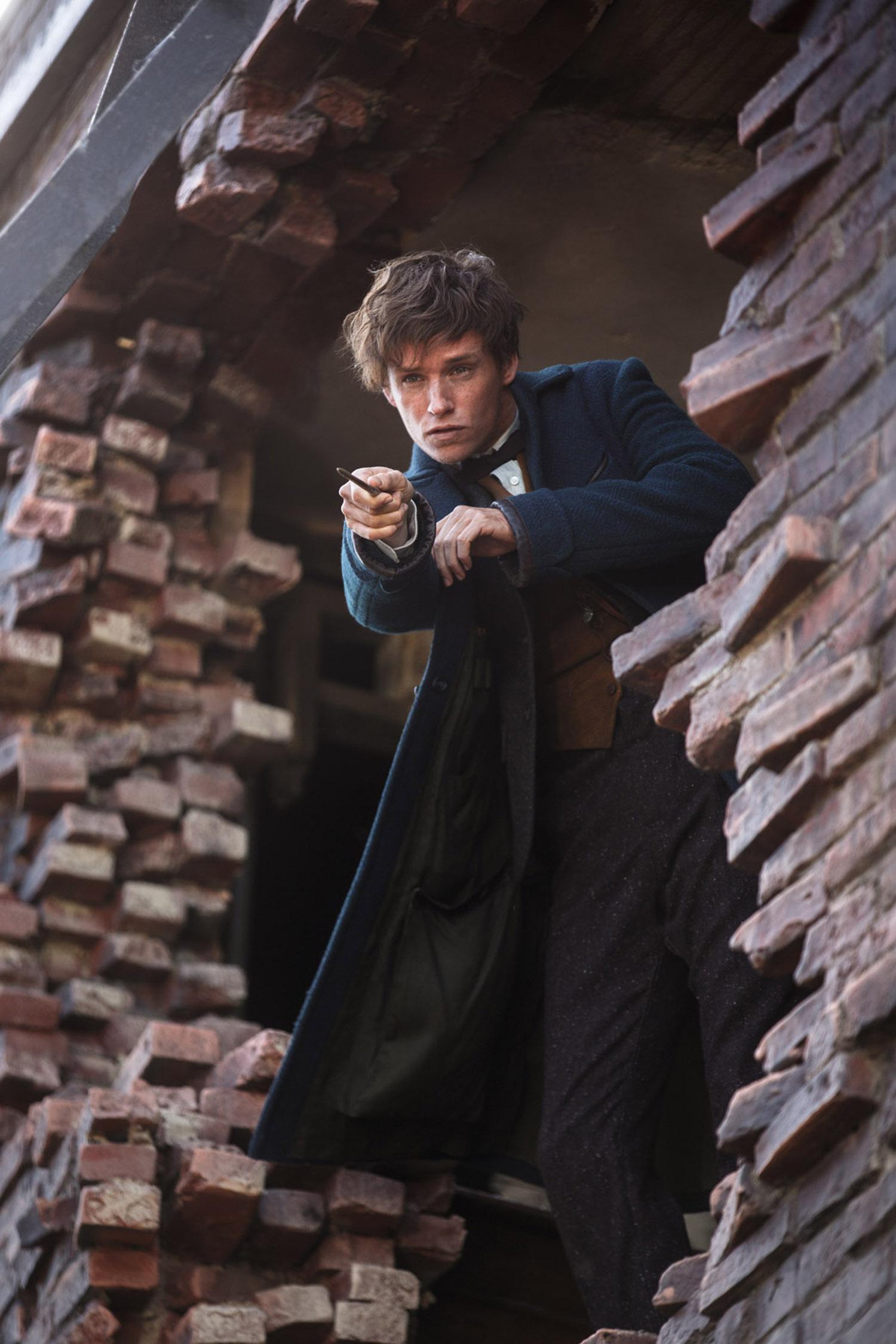 EDDIE REDMAYNE as Newt Scamander in Warner Bros. Pictures' fantasy adventure