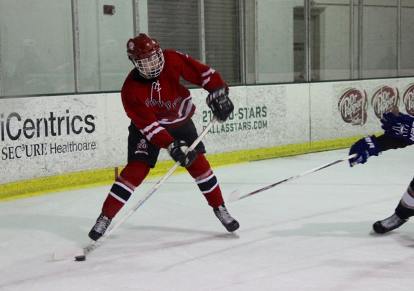 Coppell High School senior forward James Reeman looks to pass to a teammate during the first period of yesterday at the Dallas Starcenter in Farmers Branch. Reeman assisted on Coppell's only goal in a 4-1 loss to Frisco.