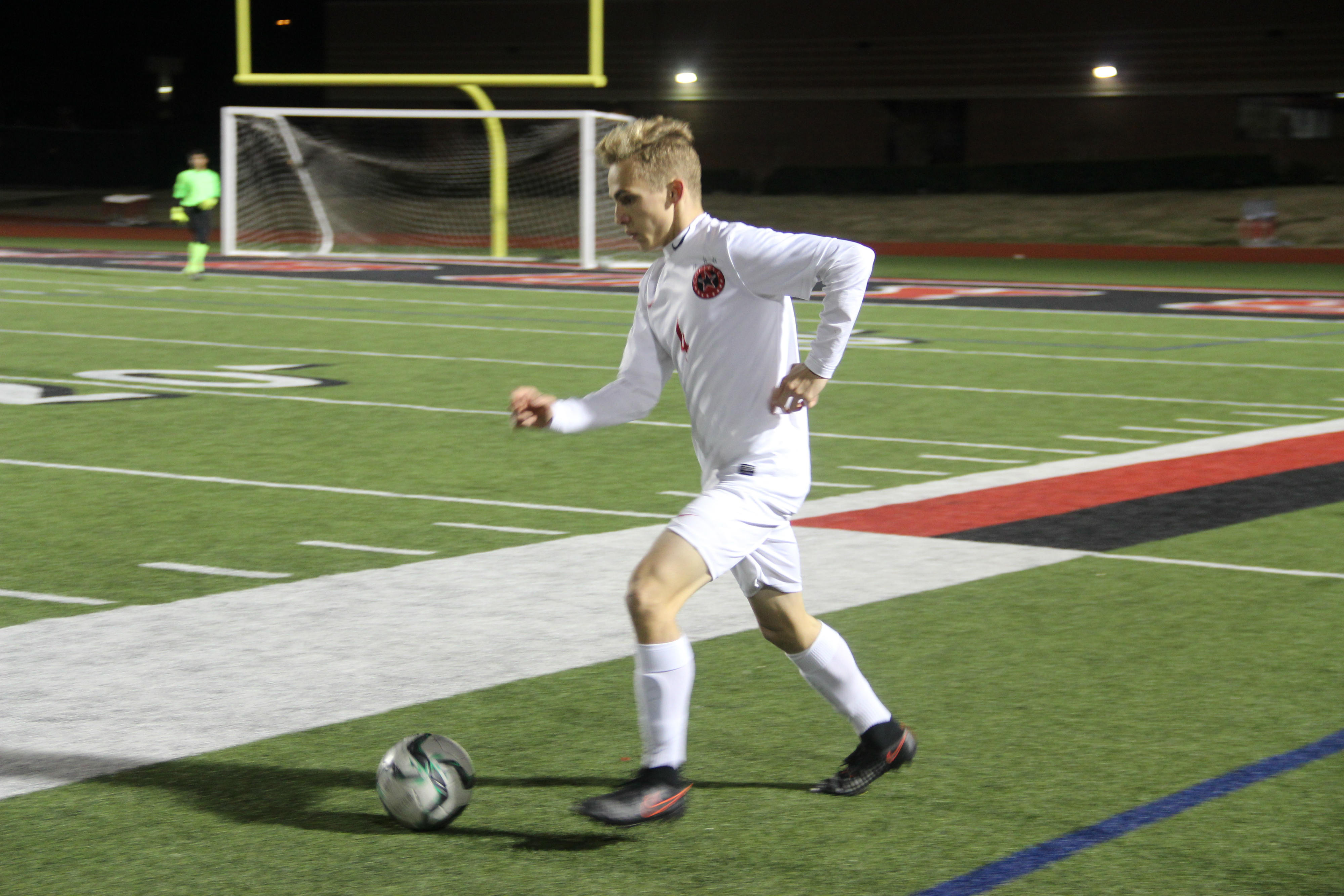 Coppell junior defender Josh Strong looks for an open passing lane in the first half of Coppell's 3-1 victory over Richardson Pearce on Friday night. Strong and the defense rebounded from an early goal to hold the Mustangs scoreless for the final 74 minutes of play.