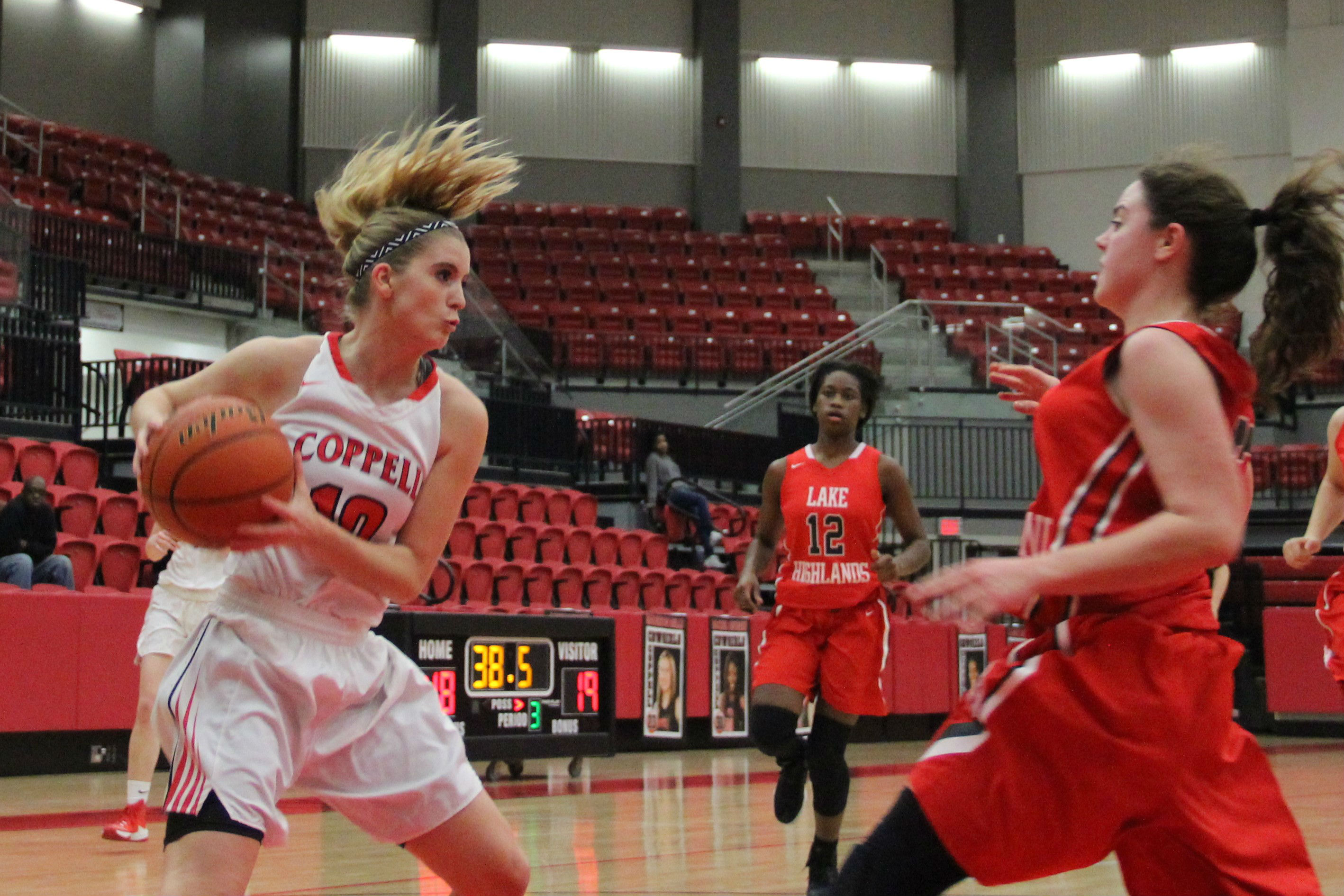 Junior guard Mary Luckett drives into the lane in Coppell's 60-30 victory over Lake Highlands on Friday night. The Cowgirls got off on a tear to start the game, leading 14-0 midway through the first quarter.