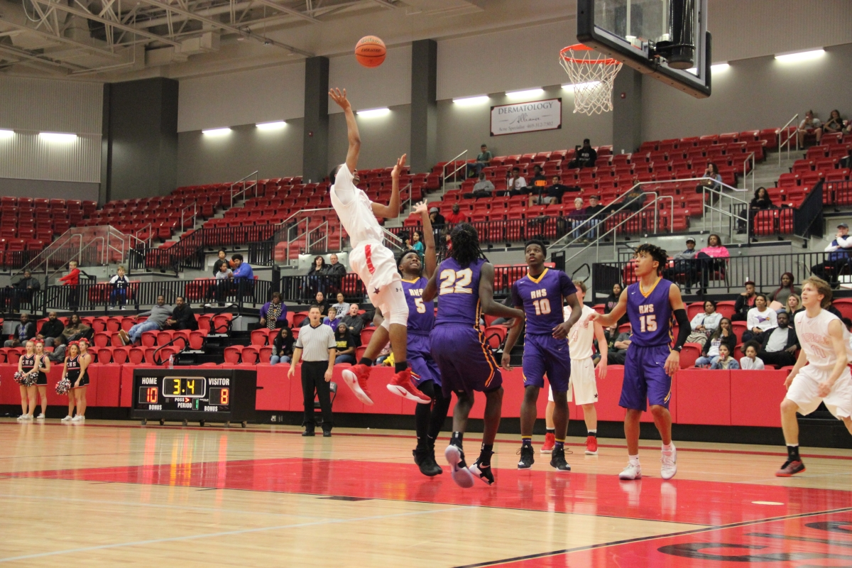 Coppell senior forward Christian Plummer shoots a running jumper over a Richardson defender in the third quarter to put Coppell ahead, 36-31. Plummer finished with 13 points in the Cowboys' 58-47 win at the CHS arena on Friday night.