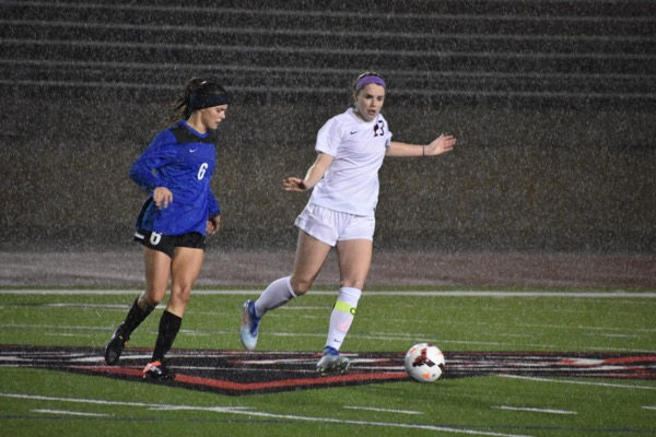 Coppell senior Sarah Houchin dribbles around Byron Nelson's defense during the first half of Tuesday night's match at Buddy Echols Field. Coppell moved to 6-0 as they beat Byron Nelson, 1-0. Photo by Ale Ceniceros