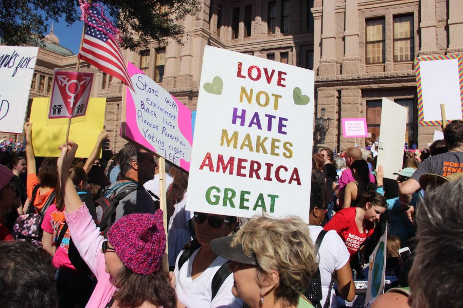A+woman+holds+a+handmade+sign+while+marching+down+West+Congress+Avenue+during+the+Women%E2%80%99s+March+on+Austin+on+Jan.+21.+The+march+began+at+the+Capitol%2C+where+a+crowd+of+50%2C000+people+gathered+in+advocacy+of+women%E2%80%99s+rights+and+civil+rights.+Photo+by+Meara+Isenberg.