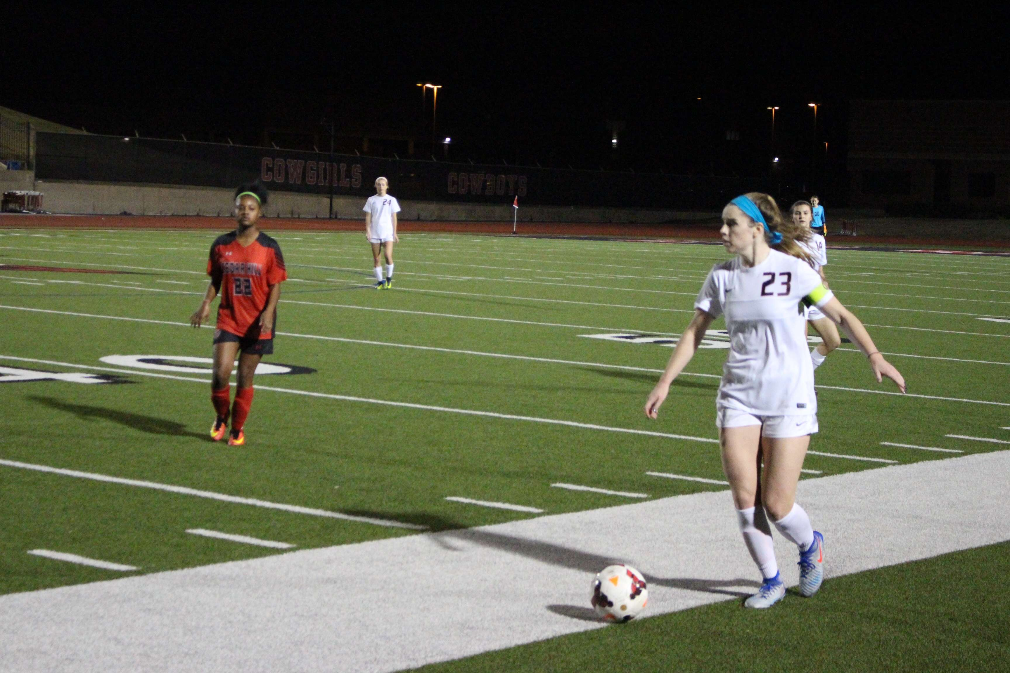 Coppell High School senior defender Sarah Houchin looks to pass to a teammate in the second half of Friday's game against Cedar Hill at Buddy Echols Field. Houchin scored a goal in Coppell's 4-0 win over the Longhorns.