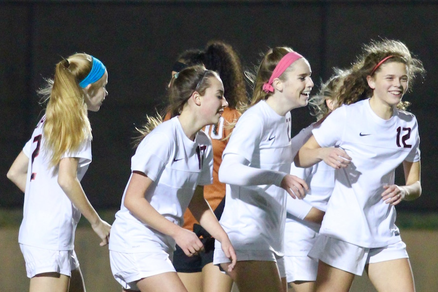 After Coppell High School junior midfielder Ty Runnels scored a goal, the Cowgirls celebrate the 4-0 lead against W.T. White at Buddy Echols Field. By the end of Friday night's match, the Coppell Cowgirls claimed a 5-0 victory over the W.T. White Longhorns.