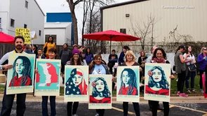 Coppell residents join the Women's March to fight for equality.