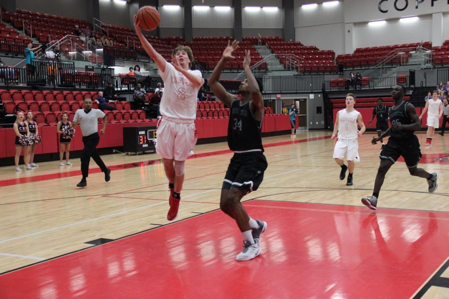 Coppell+High+School+senior+Caden+Horak+shoots+a+layup+during+the+game+against+Berkner+on+Tuesday+night+in+the+CHS+arena.+Cowboys+fell+to+the+Rams%2C+52-47%2C+falling+behind+in+the+last+few+minutes+of+the+game.+