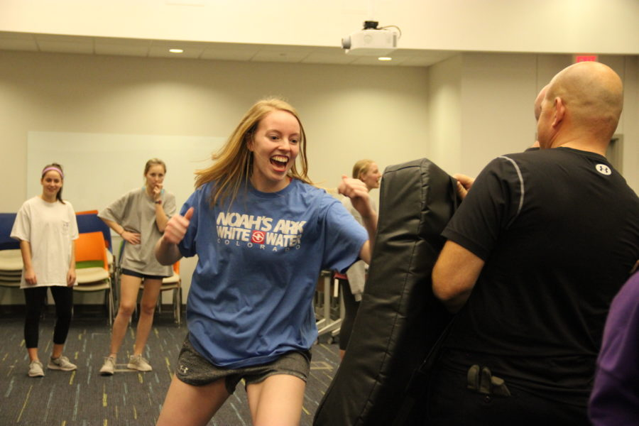Coppell+High+School+senior+Katie+Herklotz+practices+self+defense+by+punching+a+padded+shield+held+by+a+Coppell+police+officer.+Senior+girls+attending+CHS+and+New+Tech+High%40Coppell+were+offered+a+free+safety+course+to+prepare+them+for+being+on+their+own+in+college.+
