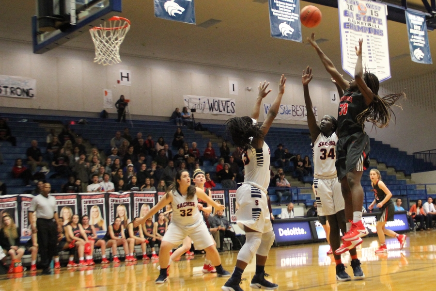 Coppell High School junior Rachel Okereke shoots the ball as the second quarter of Monday night's Class 6A bi-district game comes to a close. The Coppell Cowgirls ended their season with a 47-31 loss to Sachse at Plano West High School.