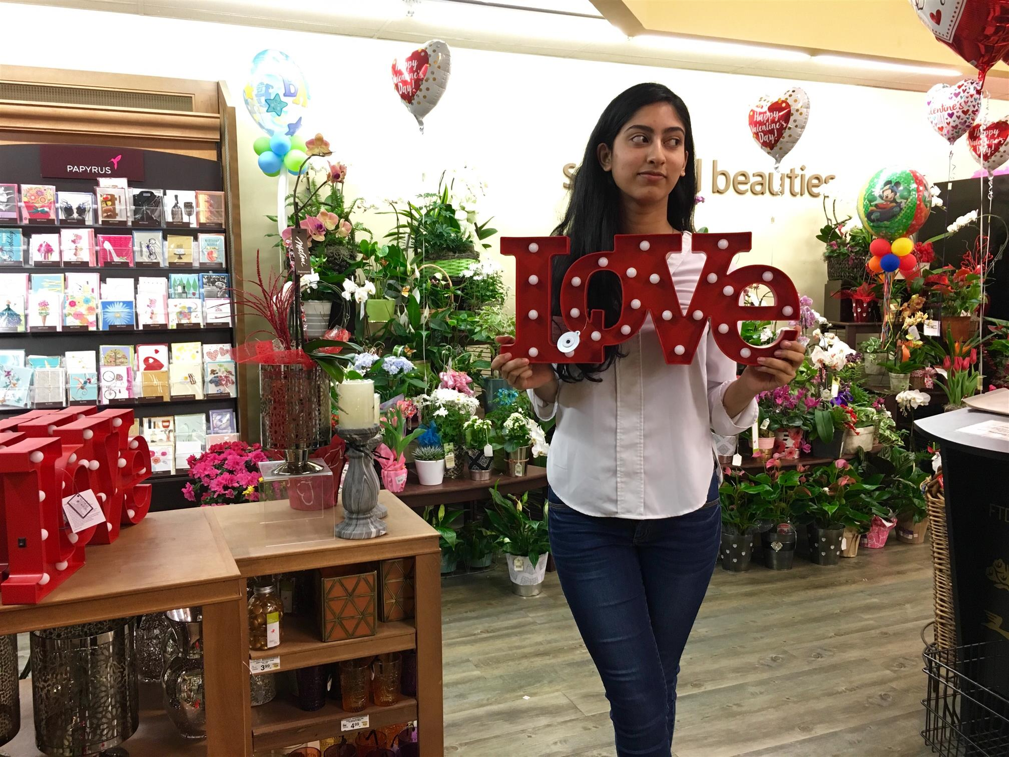 Coppell High School senior Briana Thomas visits local flower shop in Coppell. Thomas contemplates how to practice self love on Valentine's Day, while shopping for flowers and chocolate on Feb. 14, Valentine's Day.