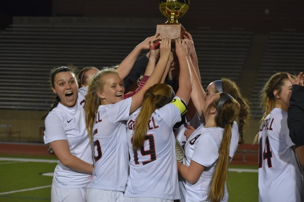 The Coppell High School girls soccer team celebrates its  District 9-6A championship after Tuesday night's win at Buddy Echols Field. Coppell defeated Skyline, 13-0.