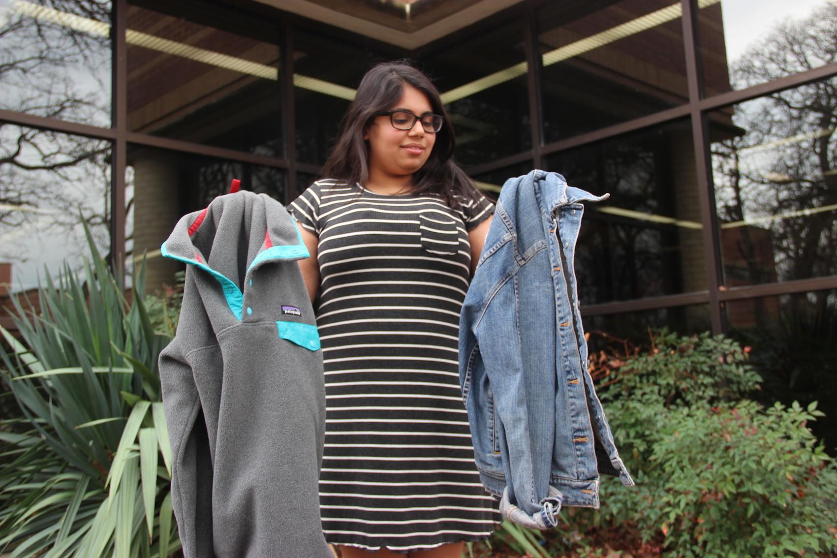 Coppell High School junior Farah Merchant decides between dressing up her outfit with a cute jean jacket or wearing a comfy sweatshirt to school. Dressing up can boost confidence and Merchant put that theory to the test last week.