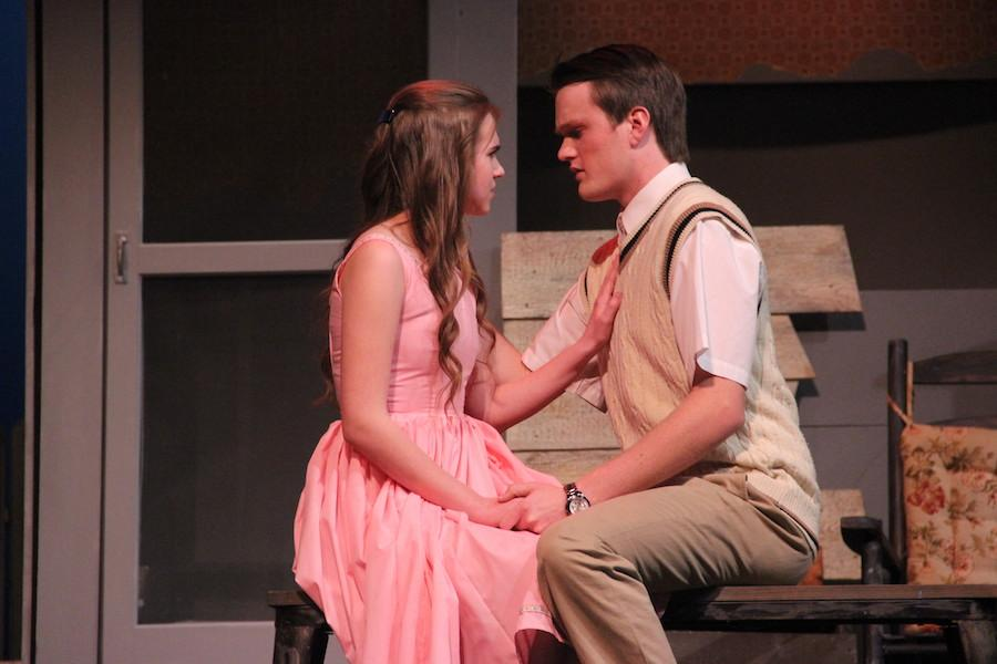 "Coppell High School senior Seth Holst leans in to kiss junior Macy Johnson when she stops him on stage during the CHS Theater Department's play ""Picnic"" in the auditorium Thursday night. Holst plays the role of Alan Seymour, current boyfriend to Johnson's character, Madge Owens."