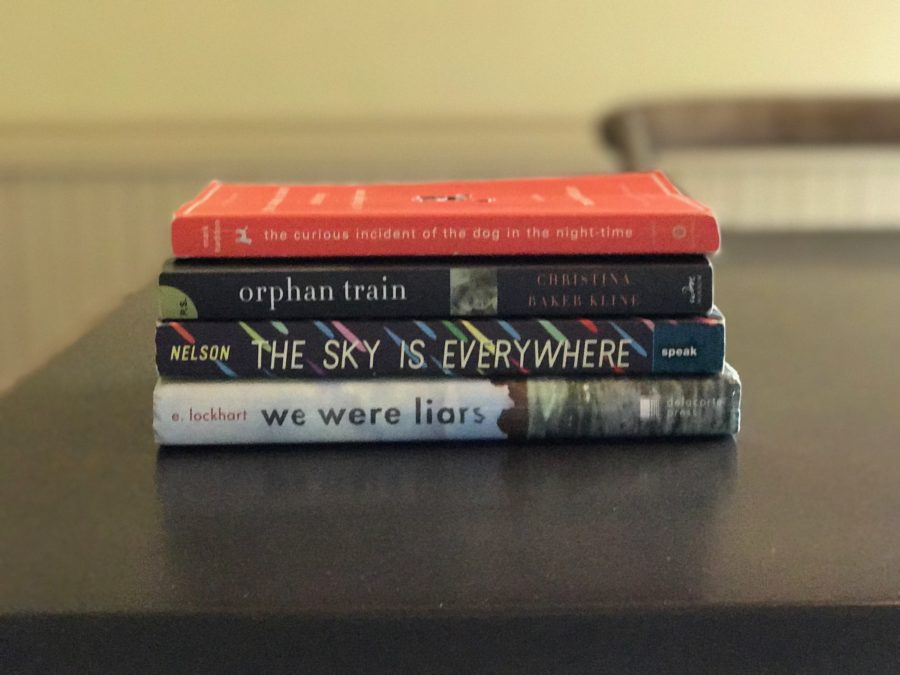 The+Curious+Incident+of+the+Dog+in+the+Night-Time%2C+Orphan+Train%2C+The+Sky+is+Everywhere%2C+and+We+Were+Liars+are+all+must+reads+for+teens.+The+books+tackle+real+life+dilemmas+while+weaving+fanciful+plots+for+readers+to+enjoy.+Photo+by+Amelia+Vanyo.