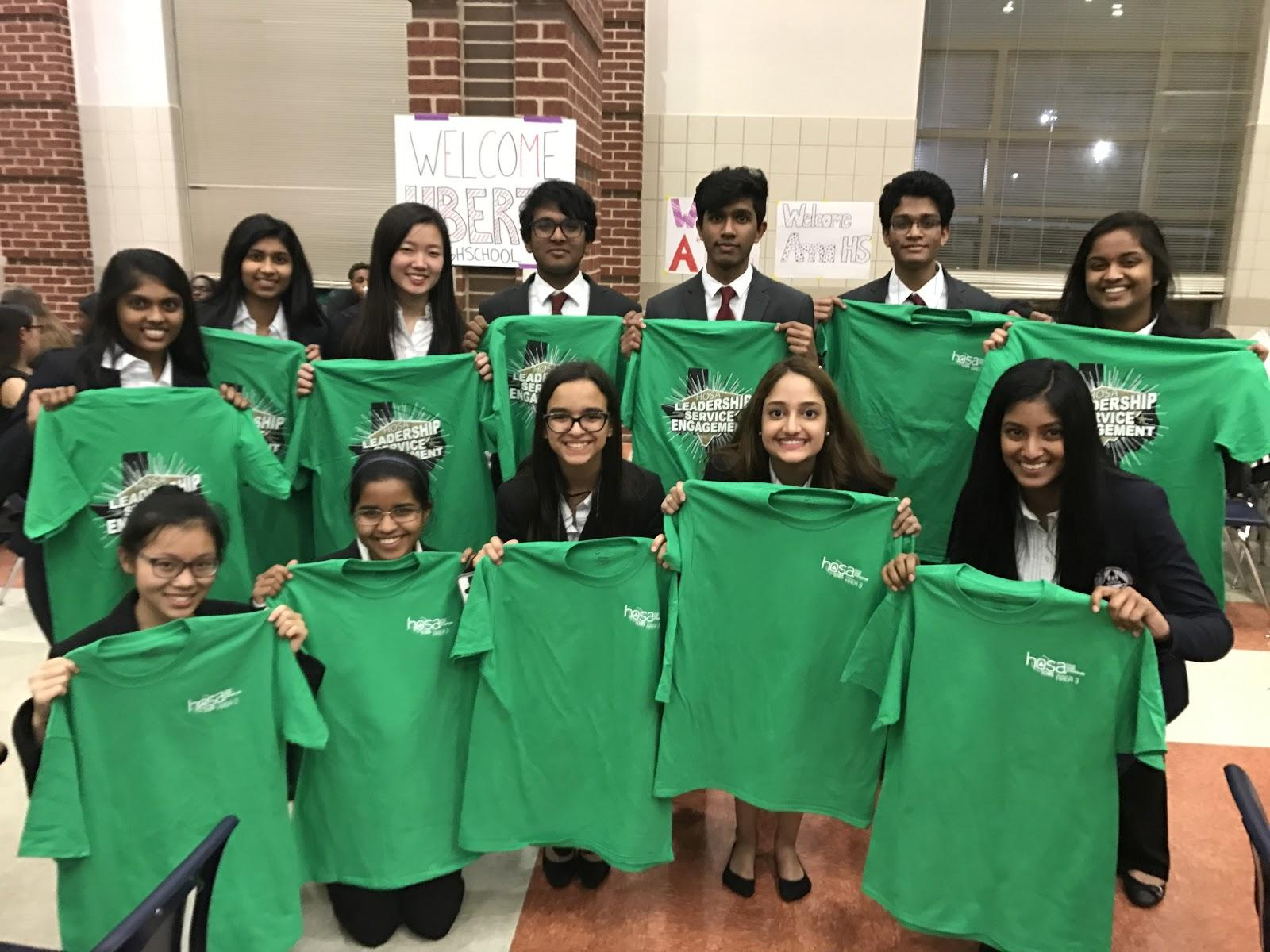 Health Occupational Students of America (HOSA) members stand with their T-shirts at the area competition on Feb. 17 and 18 at Centennial High School Frisco. 93 Coppell High School students participated and around 20 advanced to the state competition, which will be held in Corpus Christi from March 31 to April 1.
