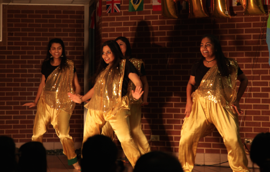 Students+Bollywood+dance+during+the+Coppell+High+School+Junior+World+Affairs+Council+%28JWAC%29+annual+Heritage+Night+on+Friday++in+the+CHS+commons.+From+hip-hop+to+bollywood+dancing%2C+the+night+of+performances+aims+to+celebrate+the+cultural+and+ethnic+diversities+present+in+the+CHS+student+body+through+music+and+dance.+Photo+by+Kelly+Wei.
