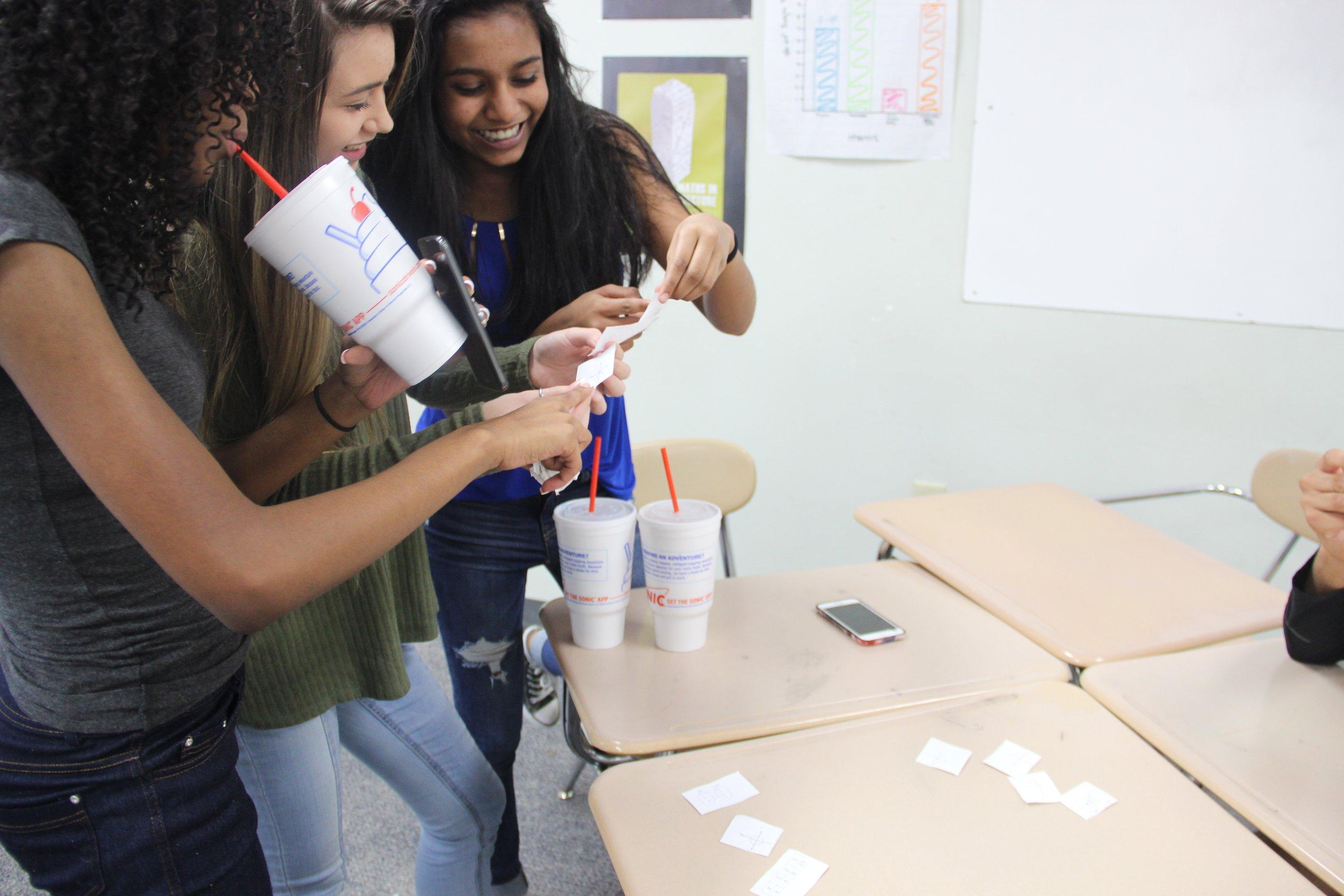 Freshman students Cierra Hargraves, Kalena Jones, and Shravani Dangety in Coppell High School Algebra I teacher Marie Flynn's classroom show parents a practice activity they performed in class during the 2017 CHS Spring Showcase. The student-led parent night from 5-6:30 p.m. offered an inside look at many CHS classrooms.