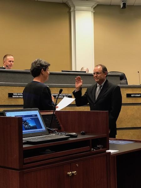 Coppell city mayor swears in Mike Land as the new city council manager on April 11 at the town hall. The rest of the evening was spent celebrating the library's excellence and approving city expenditure projects. Photo by Emma Cummins.