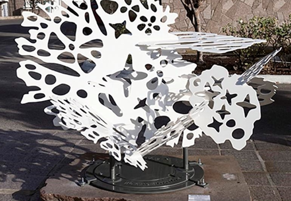 """Artist Elizabeth Akamatsu features her sculpture """"White Dust"""" in Old Town. This Saturday, a gallery of original sculptures will line the streets of Old Town Coppell to be showcased in the Old Town Art Splash exhibit. Photo courtesy of Coppell Arts Council."""