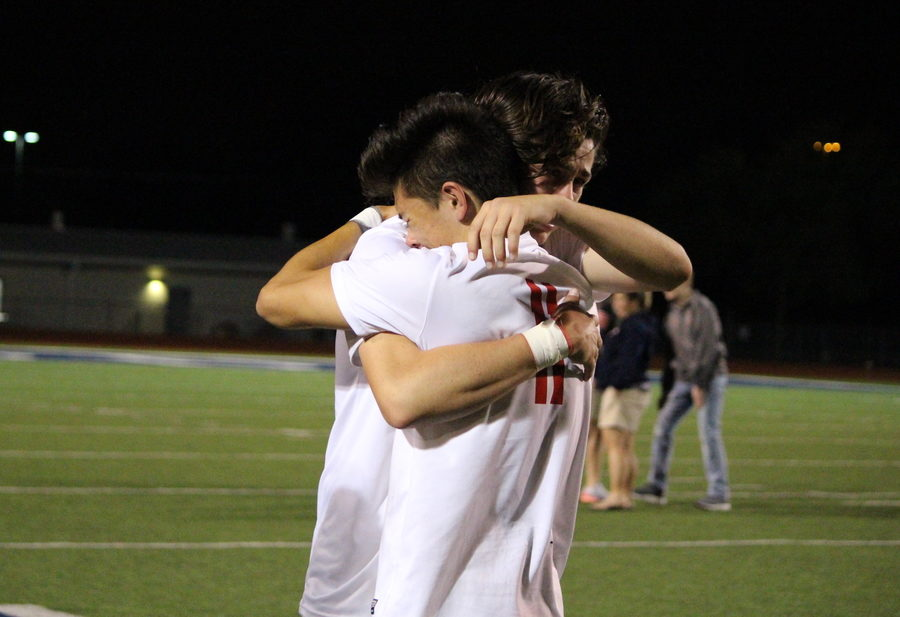 Coppell+High+School+senior+captain+and+forward+Nick+Taylor+hugs+senior+midfielder+Alex+Haas+after+their+2-1+loss+to+the+Sachse+Mustangs+in+the+Class+6A+Region+II+quarterfinals+at+Ron+Poe+Stadium.+The+Mustangs+scored+two+goals+in+the+first+half+and+despite+a+goal+from+senior+midfielder+Parker+McClure+in+the+second+half%2C+the+Cowboys+were+defeated+at+Tuesday+night%E2%80%99s+match.